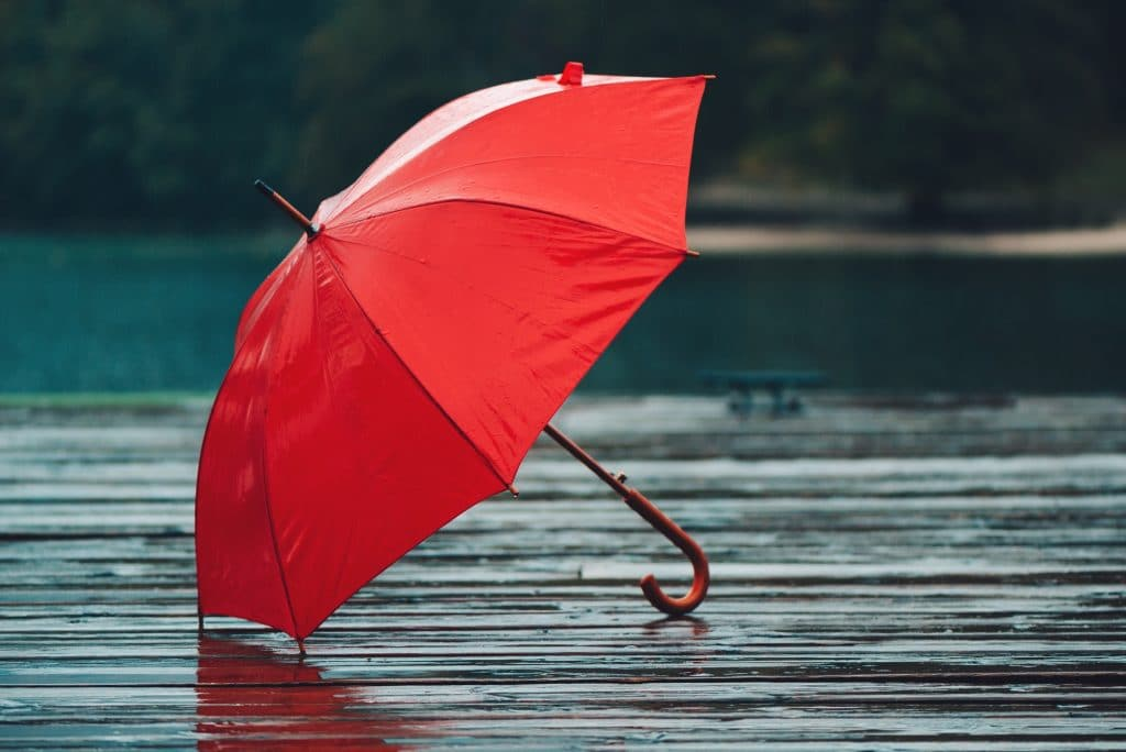Red umbrella on rain