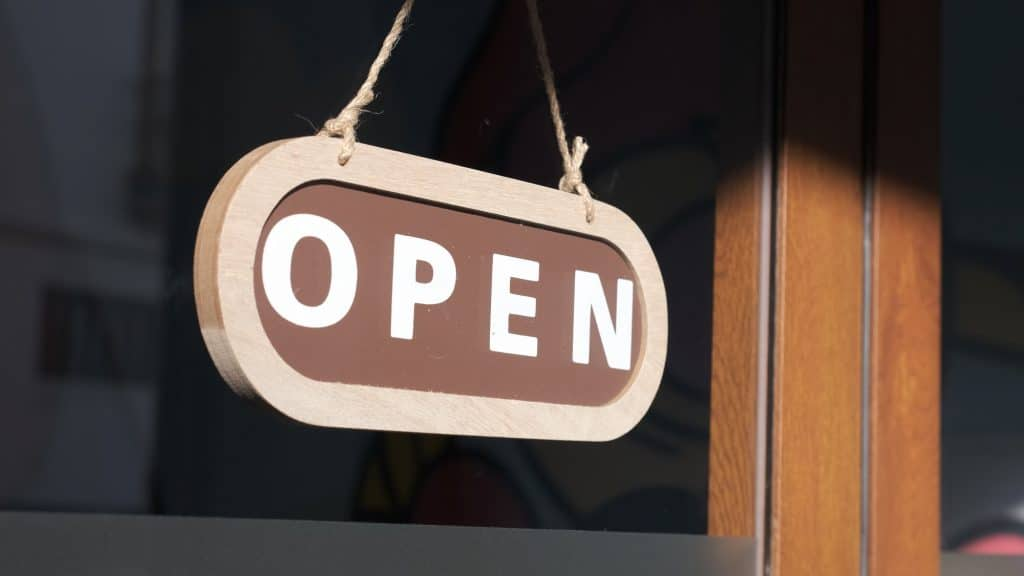 Small business opening up. Turning the sign to open